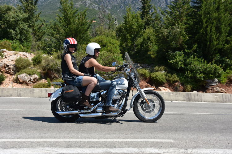Woman riding motorcycle on road