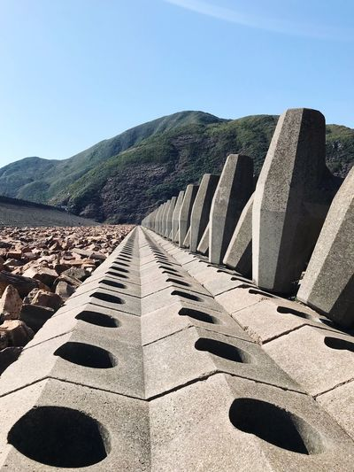 Sea Wall Day Outdoors Sunlight Mountain Clear Sky Nature Built Structure No People Architecture Beauty In Nature Sky Sai Kung In Hongkong The Architect - 2018 EyeEm Awards