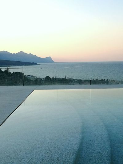 Water Nature Sunset Tranquility Sky Beauty In Nature Scenics Mountain No People Sea Sea And Sky Seascape Sea View Swimming Pool Resort Resort Hotel Your Ticket To Europe The Week On EyeEm Sicily Travel Vacations Summer