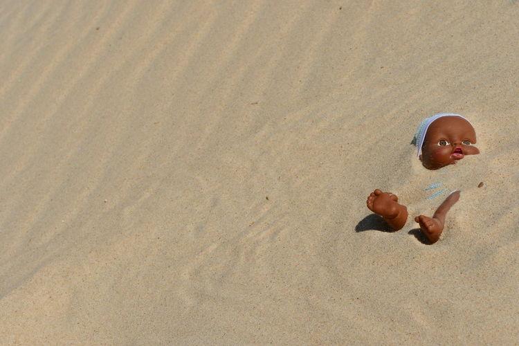 boy toy dolls buried in sand in the desert Buried Desert Desert Life Deserts Around The World Doll Doll Photography Toys Beach Beauty Beauty In Nature Boy Boys Boys Will Be Boys Buried In Sand Child Childhood Close-up Day Desert Beauty Desert Landscape Design Dolls Sand Sand Dune Toyslagram