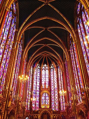 TakeoverContrast Place Of Worship Church Spirituality Religion Cathedral Low Angle View Window Stained Glass Indoors  Arch Architecture Cultures Gothic Style Multi Colored Travel Destinations Architectural Feature Temple - Building Famous Place Chapel Tourism