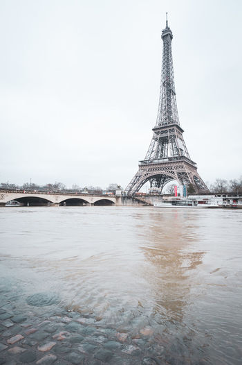 Tower Eiffle water flood in Paris, France Built Structure Architecture Sky Travel Destinations Water Tourism Tower Travel Nature City Tall - High Building Exterior The Past Day History Bridge Clear Sky No People Arch Outdoors Bridge - Man Made Structure Tower Eiffel Tower Eiffle Eiffle Tower Flood