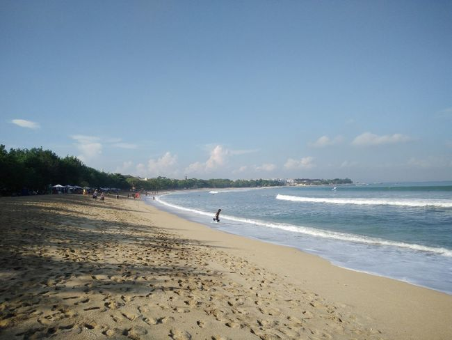 Wide view of Kuta Beach, Bali, Indonesia Beach Beauty In Nature Blue Calm Cloud - Sky Coastline Day Horizon Over Water Idyllic Nature Non-urban Scene Outdoors Remote Sand Scenics Sea Shore Sky Tourism Tranquil Scene Tranquility Travel Destinations Vacations Water Wave