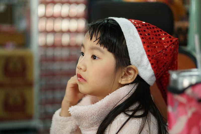 cute kid christmas celebration EyeEm Selects Childhood Child Winter Focus On Foreground One Person Clothing Celebration Looking Lifestyles Christmas Females Looking Away Red Headshot Innocence Portrait Women Real People