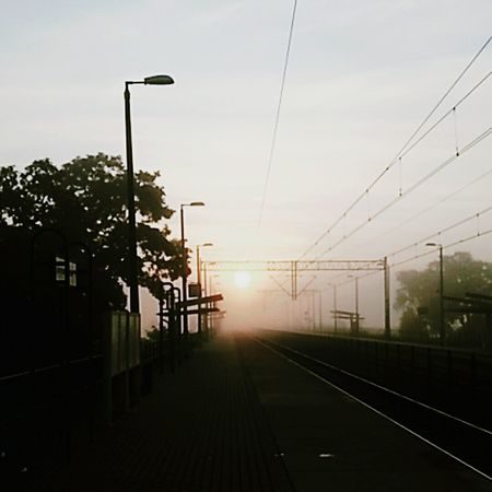EyeEmNewHere Foggy Weather Foggy Morning Foggy Fog Rail Pkp Railroad Track Cable Day Sky First Eyeem Photo No People Transportation Outdoors Sunset Nature