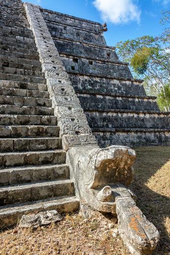 Stairs and snake head on a temple in Chichen Itza, Mexico Ancient Archeology Architecture Cancun Chichen Itza City Mayan Mexico Pyramid Temptation Travel Yúcatan Castillo Chichenitza Civilization Kukulkan Landmark Maya Mexican Old Sacred Site Stone Tourism World