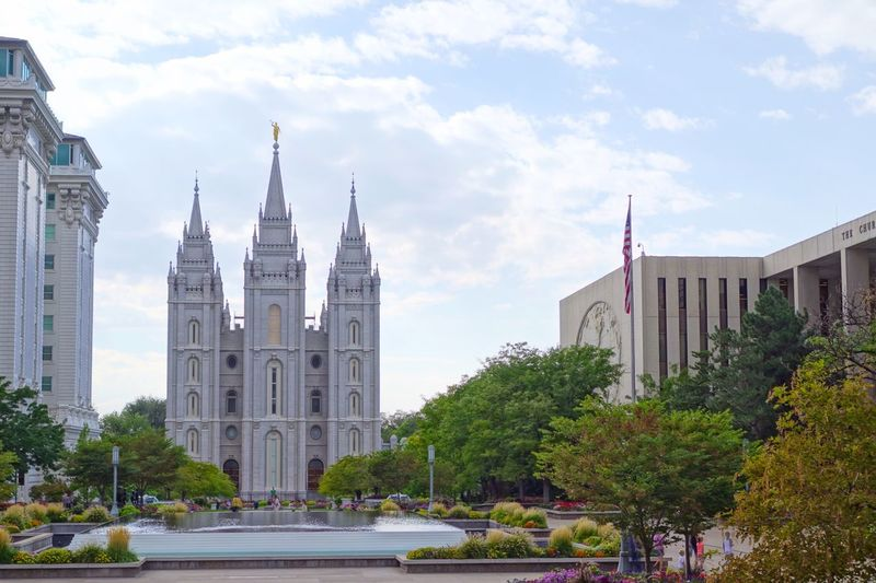 Salt lake city mormon temple and trees against sky