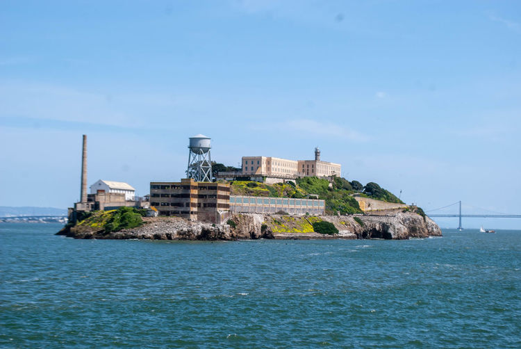 Alcatraz Alcatraz Island Water Built Structure Sky Architecture Sea Building Exterior Waterfront Building Blue Nature No People Day Travel Destinations Tower Scenics - Nature Land The Past History Outdoors