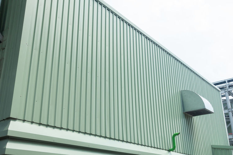 Architecture Building Building Exterior Built Structure Clear Sky Corrugated Corrugated Iron Day Factory Green Color Iron Lighting Equipment Low Angle View Metal Modern Nature No People Outdoors Pattern Railing Sky Wall - Building Feature