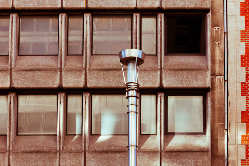 Close-up of street light against building
