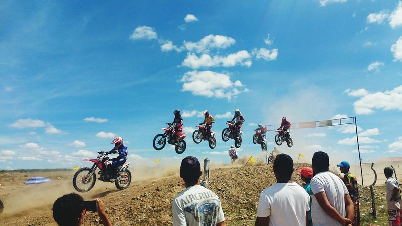 Sky Speed People Spectator Performance Motorcycle Extreme Sports Real People Sport Adults Only Togetherness Stunt Day Headwear Large Group Of People Crowd Men Skill  Cloud - Sky Adult