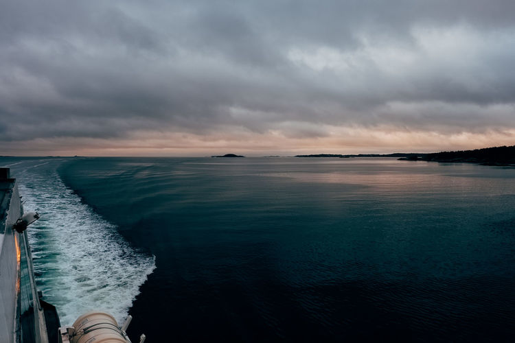 arriving in Norway Ferry Ferryboat Norway Wave Beauty In Nature Boat Cloud - Sky Horizon Horizon Over Water Idyllic Nature Nautical Vessel No People Non-urban Scene Outdoors Overcast Scenics - Nature Sea Sky Storm Sunset Tranquil Scene Tranquility Transportation Water
