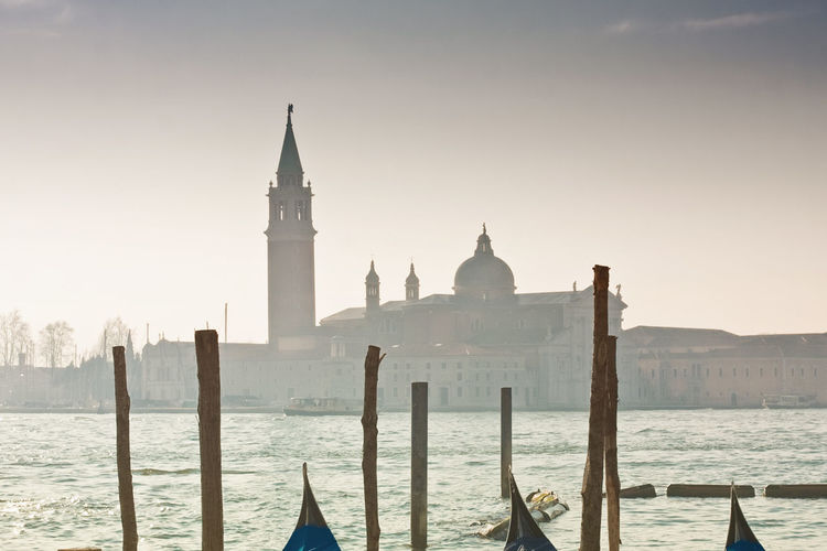 Cropped Image Of Gondolas Moored On Grand Canal Against St Marks Square