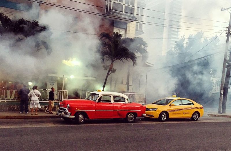 Pest control, Cuba style! Trucks drive around spraying neighbourhoods. Mist Fog Urban Landscape Auto Automobile Cars Red Car Fresh 3 IPhoneography Travel Photography Urbanexploration Urbanphotography Streetphotography Street Photography Eye4photography  EyeEm Gallery Urban Spring Fever