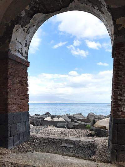 Throught the door! Sky Arch Day Sea Water Cloud - Sky Sunlight Rock - Object Horizon Over Water Nature Built Structure No People Scenics Beauty In Nature Architecture Outdoors Dayoff Beach Southitaly Naples Italy Building Exterior Summertime Summer Vesuvio