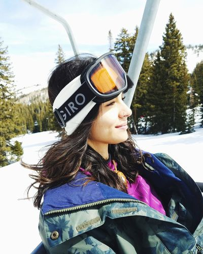 Warm Clothing Tree Young Women Portrait Snow Cold Temperature Winter Smiling Snowboarding Headshot