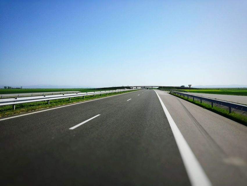 Road Highway The Way Forward Asphalt Transportation Clear Sky Outdoors Direction Straight Day Airport Runway Blue Sky No People Nature Highwayscape Roadway Highway Photography Roads Speedway Speed Blur Motion Blur Blur Straight Transportation