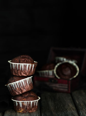 chocolate muffins stacked infront of a dark background | daylight foodphotography Chocolate Dessert Homemade Homemade Food Nikon Baked Black Brown Brown Color Dark Background Daylight Focus On Foreground Food Food Photography Foodphotography Moody Muffin Muffins Stacked Still Life Sweet Food White