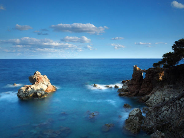 Landscape of Lloret de Mar, Costa Brava - Girona, Spain Costa Brava Girona Lloret De Mar Travel Beach Beauty In Nature Blue Horizon Over Water Idyllic Lloret Lloretdemar Long Exposure Nature No People Ocean Outdoors Rock Rock - Object Rock Formation Scenics Sea Sea View Seaside Tranquil Scene Water