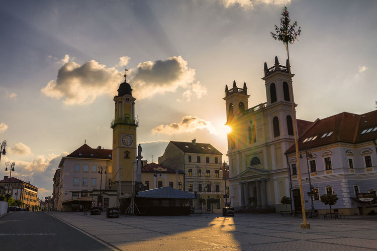 in the morning in the town Building Exterior Built Structure Architecture Sky Nature Outdoors Building Cloud - Sky City Street Sunlight Place Of Worship Sun Religion Sunset Belief Sunbeam Transportation Spirituality No People Lens Flare