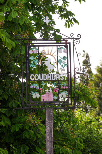 Goudhurst, Kent, England. Goudhurst is a village in Kent on the Weald, about 12 miles south of Maidstone. It stands on a crossroads, where there is a large village pond. Plant Text Communication Sign Western Script Nature Day No People Growth Information Green Color Tree Information Sign Outdoors Low Angle View Leaf Plant Part Architecture Guidance Capital Letter Message Oast House Garden Of England Beer Pond Getty Images Vivid International Brewing Village Rural Scene Ww1 Memorial First World War Remembrance Travel Destinations Tourism Tranquil Scene Water Reflections