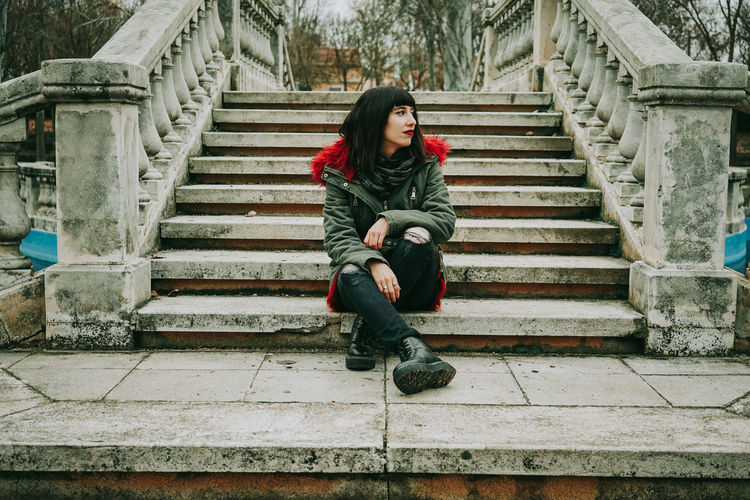 Portrait of woman sitting on staircase
