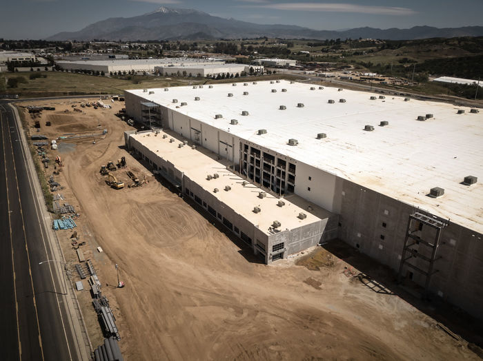 Beaumont, CA / USA - 4/20/2019: Overhead view of a new Amazon Fulfillment Center under construction. High Angle View Day Architecture Built Structure No People Outdoors Construction Construction Site Warehouse Distribution Logistics Equipment New Building  Amazon Overhead View Industry Nature Water Transportation Environment Building Exterior Fuel And Power Generation Land Mode Of Transportation Sky Business Sunlight Sea