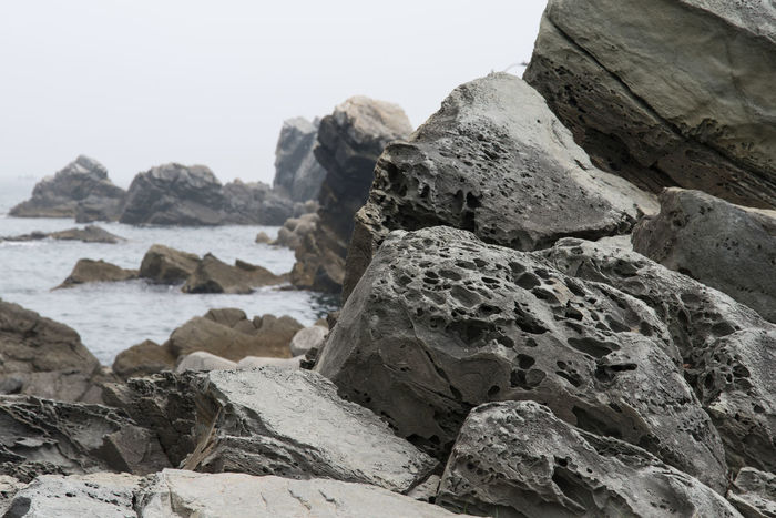 seaside view at Simgok in Gangreung, Gangwondo, South Korea Beauty In Nature Clear Sky Day Mountain Nature No People Outdoors Rock - Object Rock Formation Rocks Sea Seaside Sky