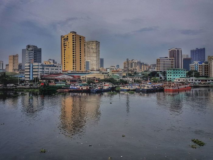Modernization Gloomy Weather River River View Riverbank Reflection Urbanization Urbanmanila Urbanjungle Urbanscape Cityview Cityscape Landscape Urbanphotography Landscapephotography Mobilephotography Galaxys7 Snapseed Pasigriver Manila Philippines Skyscraper Architecture Water Urban Skyline City Modern Building Exterior No People Sky