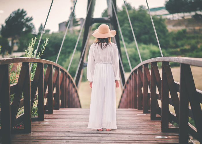 Woman standing on footbridge