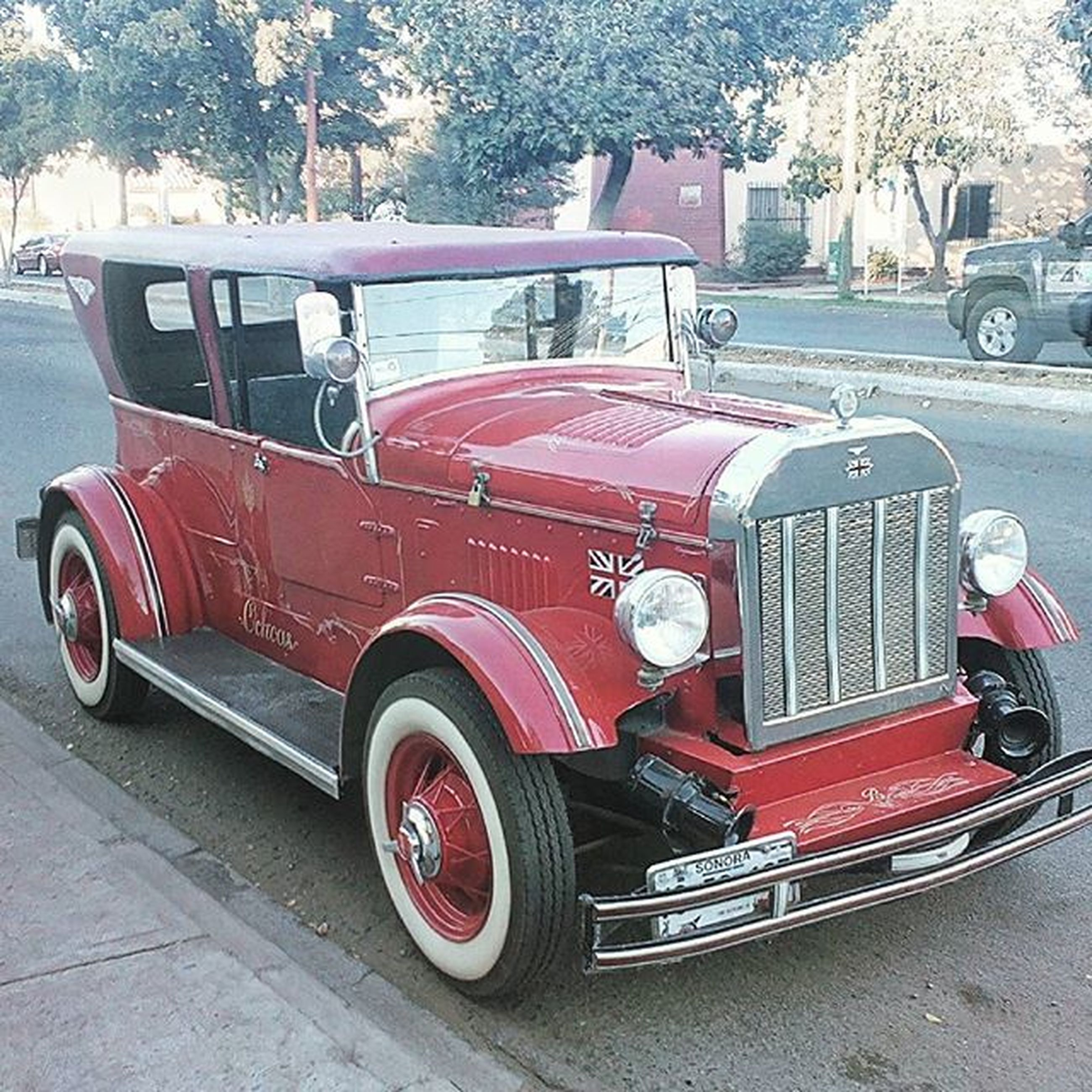 land vehicle, transportation, car, mode of transport, street, stationary, road, red, travel, parked, day, parking, vintage car, outdoors, truck, building exterior, old-fashioned, retro styled, tree, vehicle