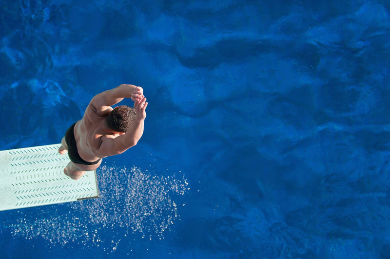 Directly above shot of man jumping in pool
