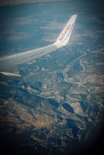 Flying over Spain Aerial View Air Europa Air Vehicle Aircraft Wing Airplane Alone Day Dramatic Landscape Flying Flying High Journey Mode Of Transport Mountain Nature No People Non-urban Scene Outdoors Part Of SPAIN Sunny Transportation Travel
