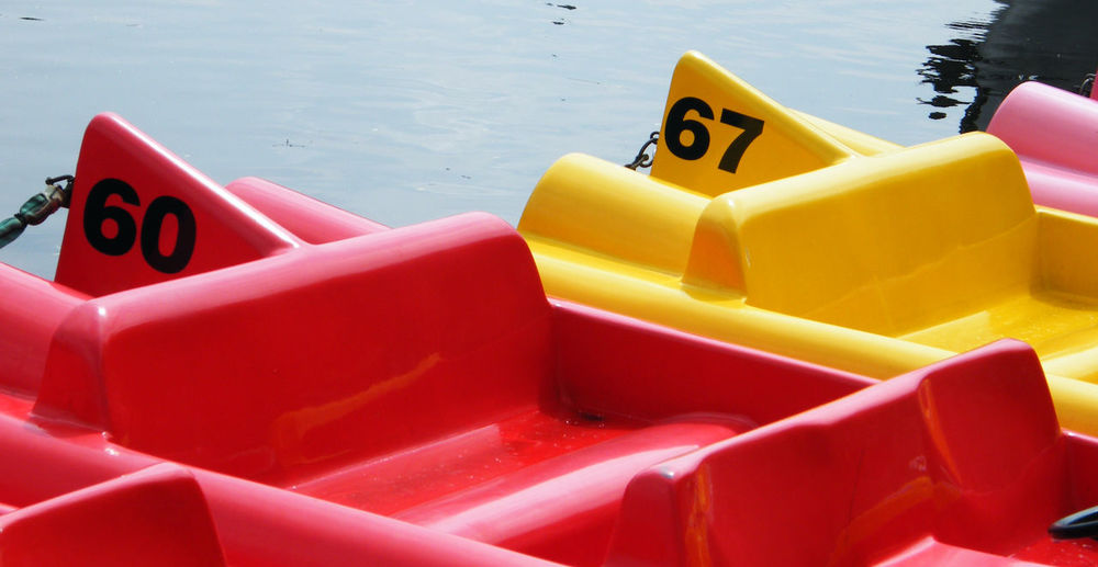 Close-up of red and yellow paddle boats