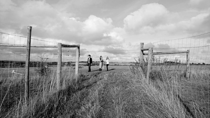 Landscape Sky Tranquility Walking Togetherness Field Cloud - Sky Cloud Person Grass Fence Friends Grass Fence Sky Landscape Safety Protection Walking Tranquility Full Length Cloud Day Togetherness Tranquil Scene First Eyeem Photo
