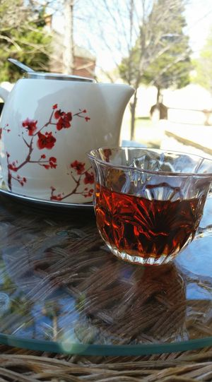 Gorgeous spring day means relaxing in the backyard with hot tea while sorting through photos. Springtime Backyard Beauty Flower Teapot Persian Tea