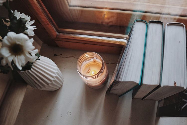 Books and candle Morning Home Home Decor Candle Bookshelf Books Book Indoors  High Angle View No People Home Interior Day Architecture Flower