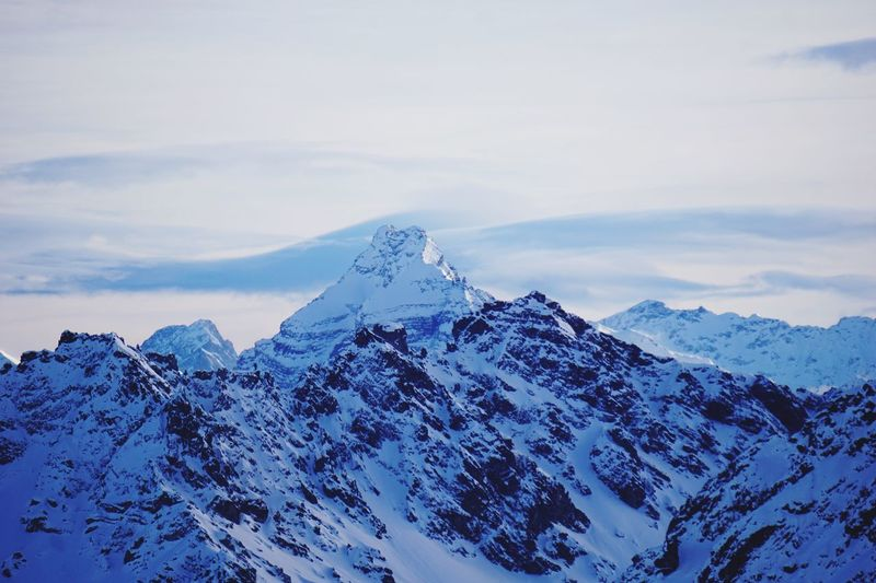 Mountain Range in Snow EyeEm Selects Snow Mountain Winter Cold Temperature Beauty In Nature Snowcapped Mountain Scenics - Nature Sky Tranquility Tranquil Scene Cloud - Sky Mountain Range Nature No People Environment Non-urban Scene Landscape Idyllic Majestic Mountain Peak