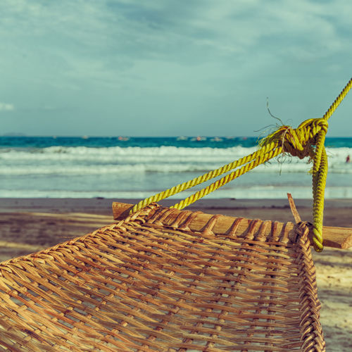 Close-up of rope on beach against sky