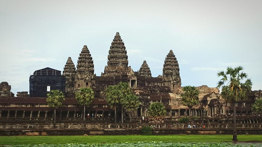 Wonders Of The World Cambodia Cambodia Tour Angkor Wat Angkor Wat, Cambodia Riverside Religion Religious Architecture Religious  National Flag National Landmark Hindu Hindu Temple Hinduism Vishnu Carnival Crowds And Details