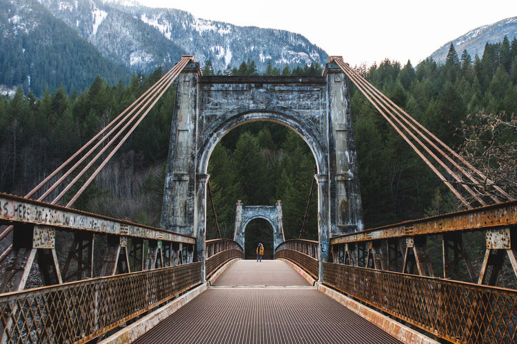 Bridge against mountain