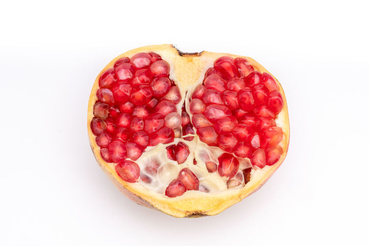 Attractive fruit in color, pomegranates Anticancer Barren Cold Temperature Delicious Drought Resistant Food Fruit Heart Insect Repellent Mature Adult Medicinal Micronutrients Nutrition Pomegranate Pomegranate Seeds Red Heart Rich Seeds Supplement Sweet Temperate Zone Tropical Vitamins Water Food And Drink Studio Shot White Background Healthy Eating Freshness Wellbeing Red Indoors  Cut Out Still Life Close-up No People Berry Fruit Sweet Food Directly Above Single Object High Angle View Ready-to-eat Temptation Ripe Tart - Dessert Snack