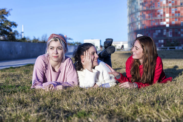 Portrait of three girlfriends lying on the grass in a park in autumn Women Child Group Of People Girls Childhood Family Adult Females Lying Down Togetherness Mother Parent Offspring Happiness Smiling Emotion Nature Grass Daughter Son Sister Outdoors Happy Looking At Camera Friendship Bestfriend Stundent Females Casual Clothing Teenager Young Women Students Denim Stylish City Street Daylight Bright Lifestyle
