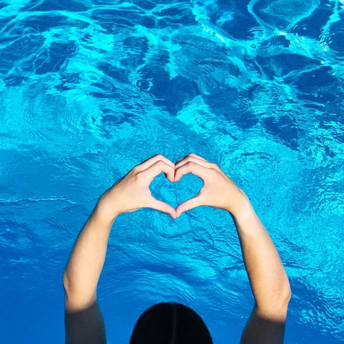 High angle view of heart shape in swimming pool