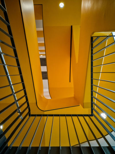 Low angle view of yellow staircase in building