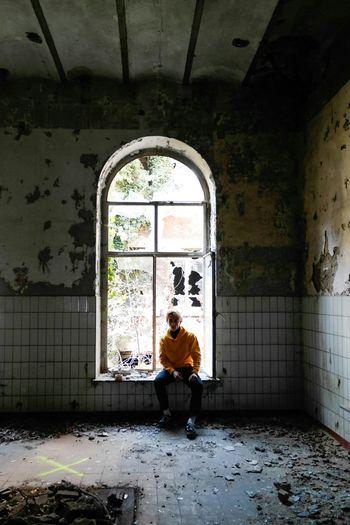 Woman standing in window