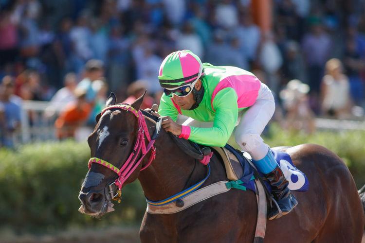 Full Length Of Jockey Riding Horse