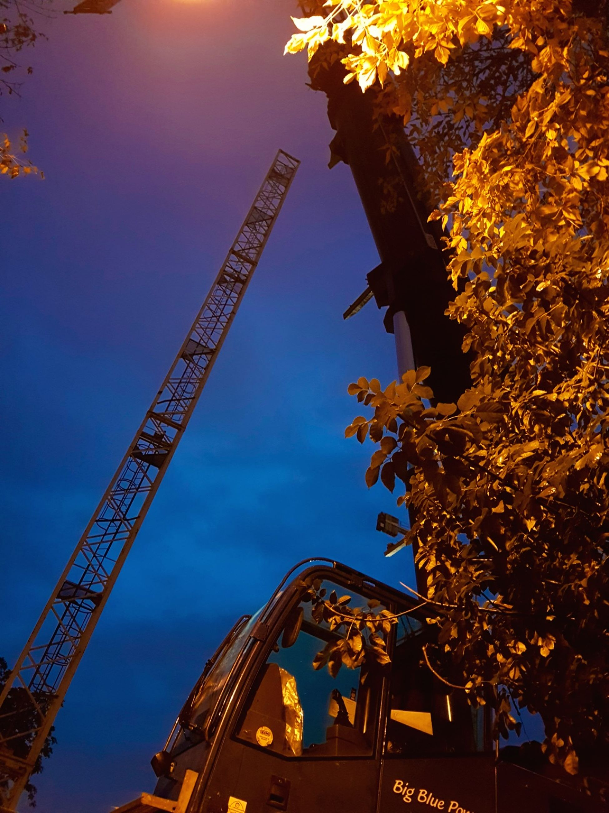 low angle view, crane - construction machinery, development, travel destinations, tall - high, built structure, tower, outdoors, sky, illuminated, capital cities, cloud, blue, growth, construction machinery, nature, day, tourism, no people, progress, famous place, eiffel tower, iron