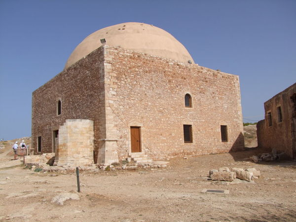 Mosque Sultan Ibrahim Han, Fortezza Castle Arid Landscape Blue Sky Building Exterior Castle Composition Dome Façade Fort Fortezza Full Frame Greece Incidental People Mosque Outdoor Photography Religion Rethimnon Stone Building Sunlight And Shade Tourism Tourist Attraction