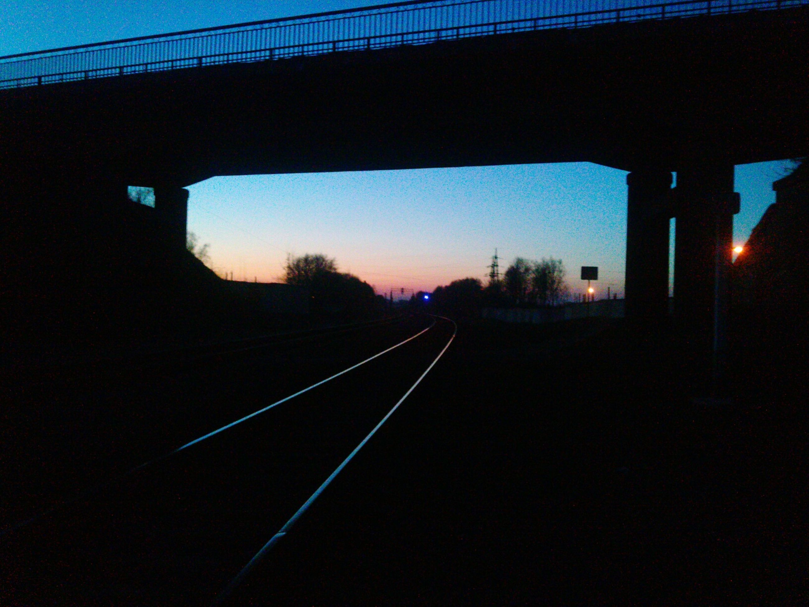 transportation, sunset, the way forward, built structure, connection, railroad track, architecture, diminishing perspective, sky, rail transportation, vanishing point, bridge - man made structure, road, silhouette, long, sunlight, no people, dusk, empty, outdoors